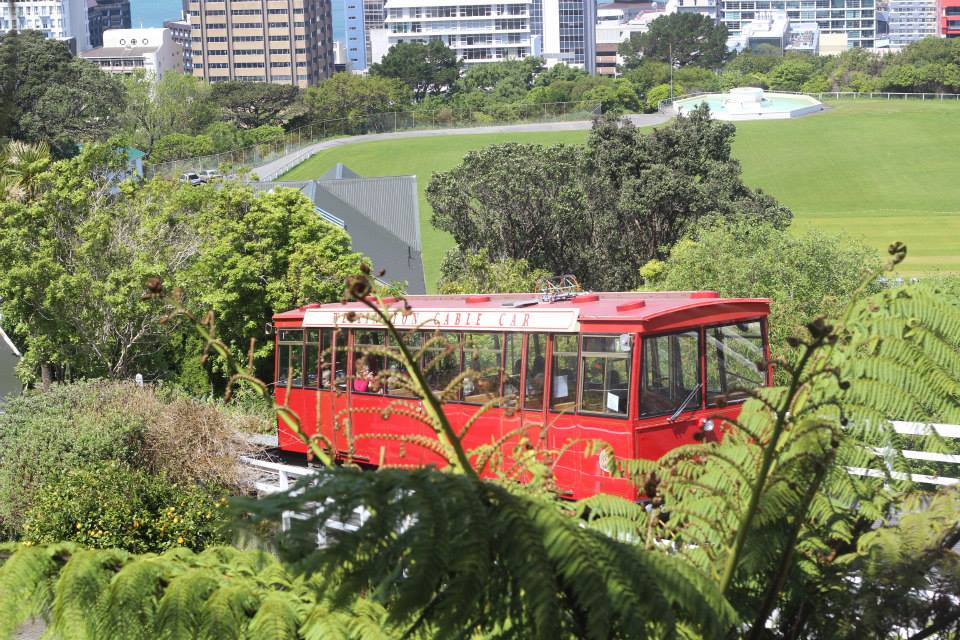 The red Wellington Cable Car in New Zealand ascending to the Botanical Gardens.