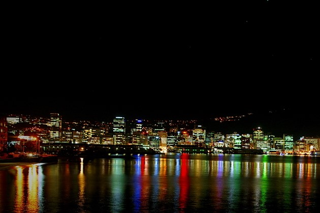 Wellington bay at night reflects the lights of the night market.