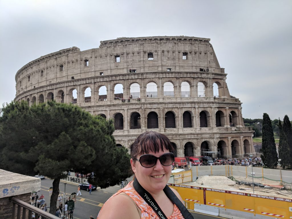 Fun facts about the Colosseum, Rome. Selfie in front of the Colosseum during our first of two visits!