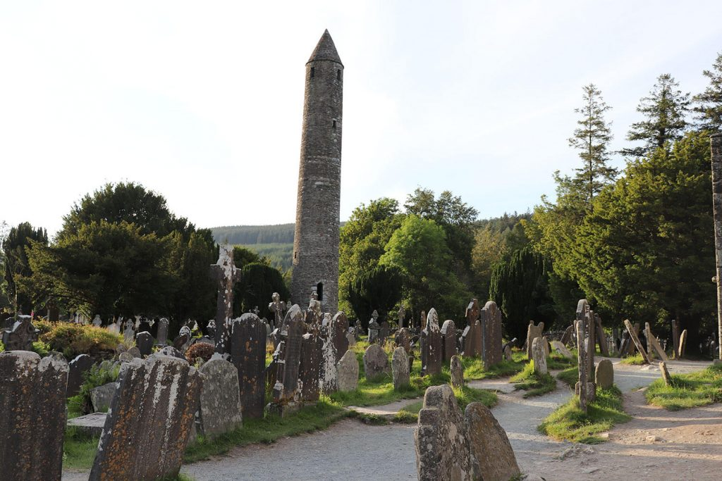 The Glendalough Monastic Ruins are a unique place to visit in Wicklow. Some of the ruins are over 1,000 years old - making it one of hte oldest places on this Ultimate Ireland Bucket List!