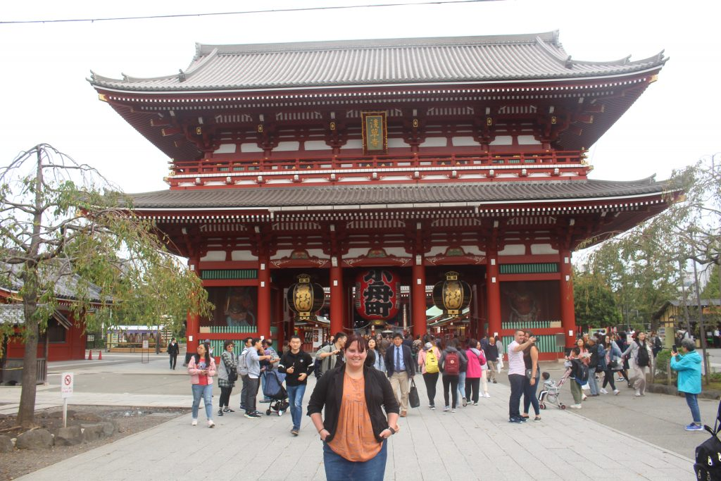 Me in front of Tokyo's Senso-Ji tower. This is also a great place to find a place to eat in Tokyo.