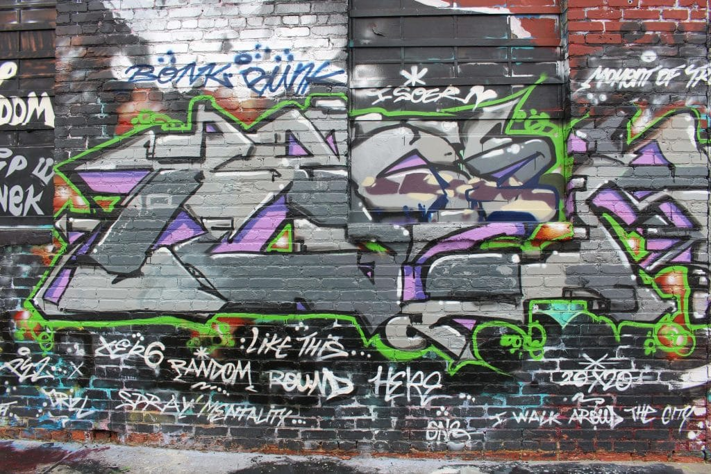 Graffiti Alley is one of the most unique places to visit during your weekend getaway to Baltimore.