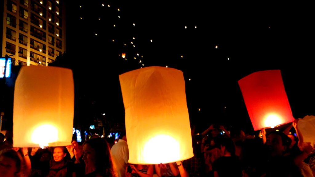 Paper lanterns decorate Chang Mai skies on NYE. It's one of the most unique places to celebrate NYE around the world.