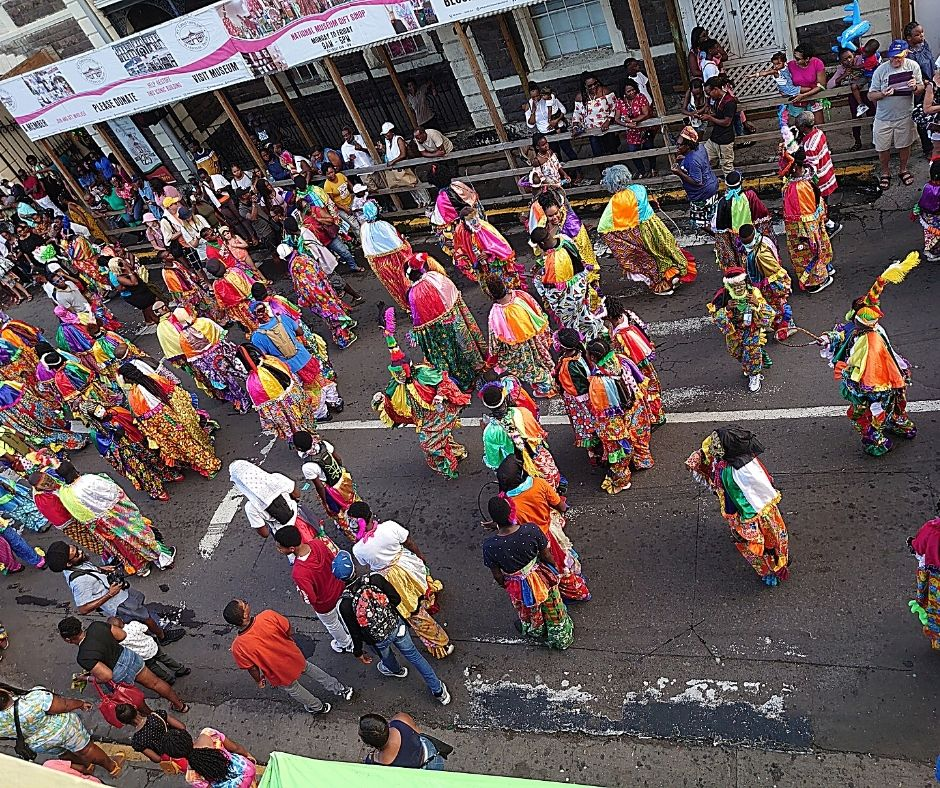 A colorful parade is a highlight of NYE in St. Kitt's - one of the best places to spend New Years Eve