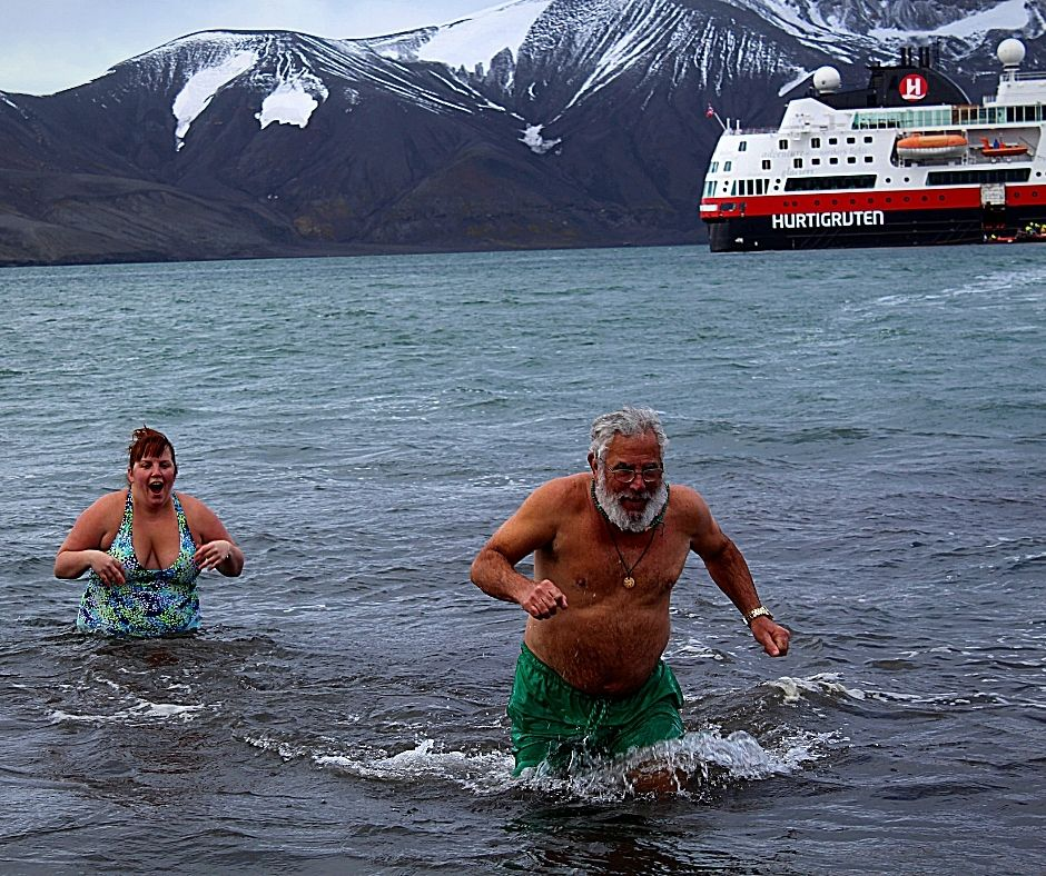 Me and Dad swimming at Deception Island for our Polar Plunge in Antarctica.