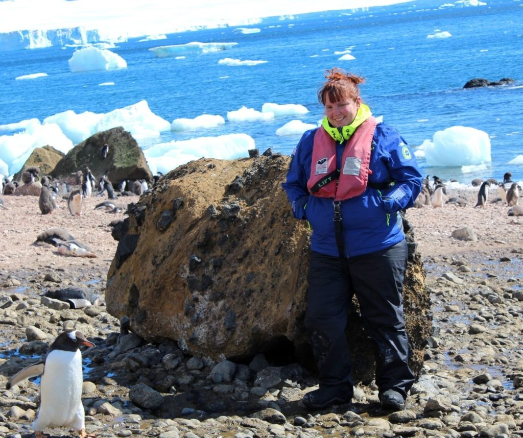 Me with a penguin in front of me. Walking with penguins is a great ethical animal encounter.