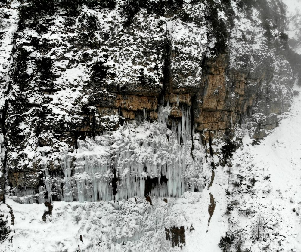 An ice cave in the Dolomites. Hiking in the Dolomites  is one of the best things to do in Italy in winter.